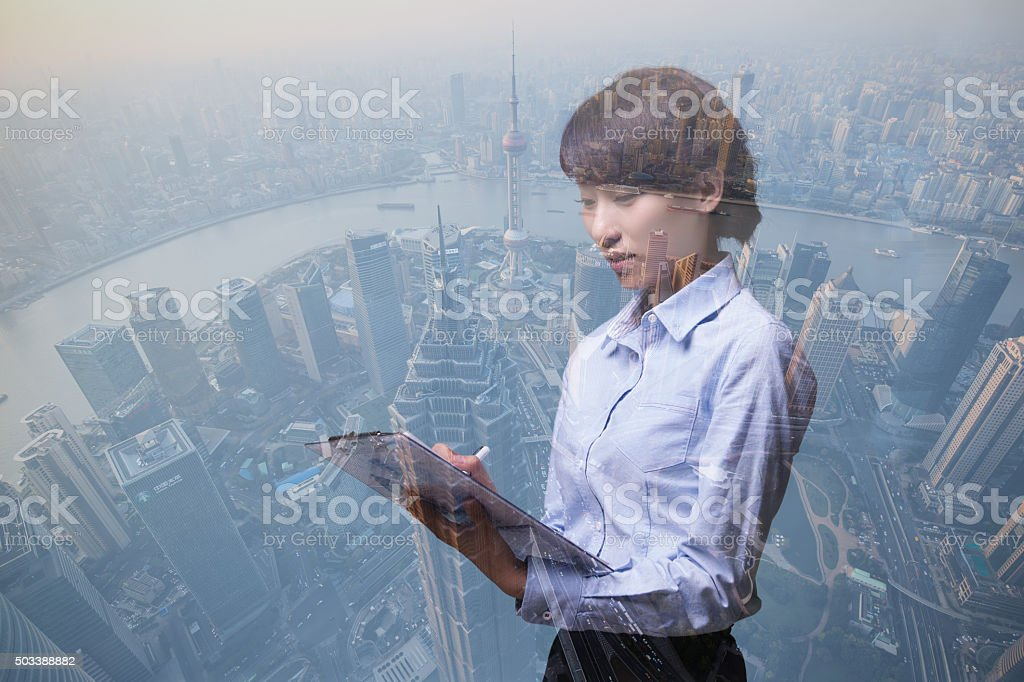Young Asian business woman holding reports stock photo