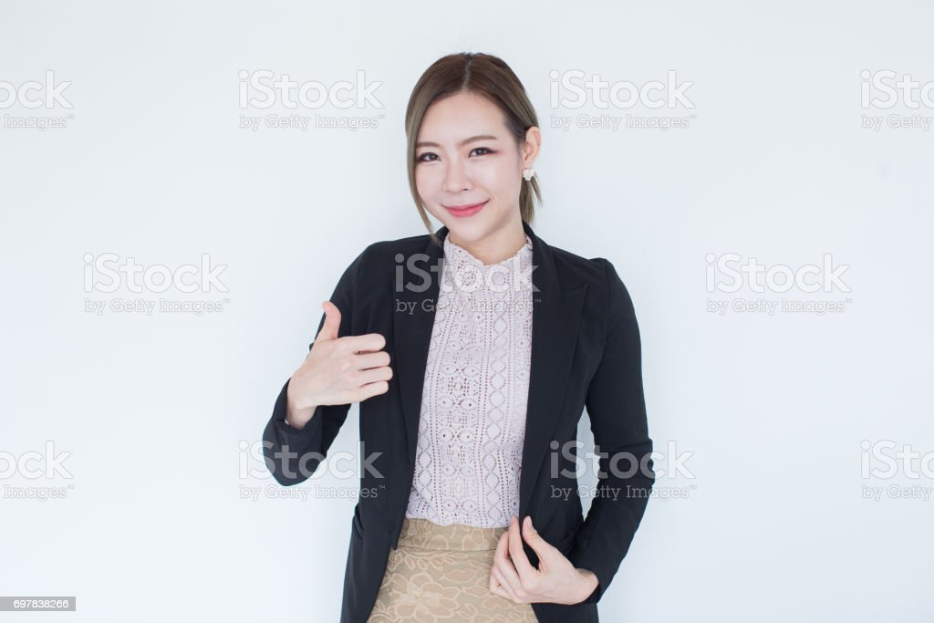 Young asian business woman smiling on background with copy space stock photo