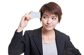 Young Asian business woman think with a blank card.