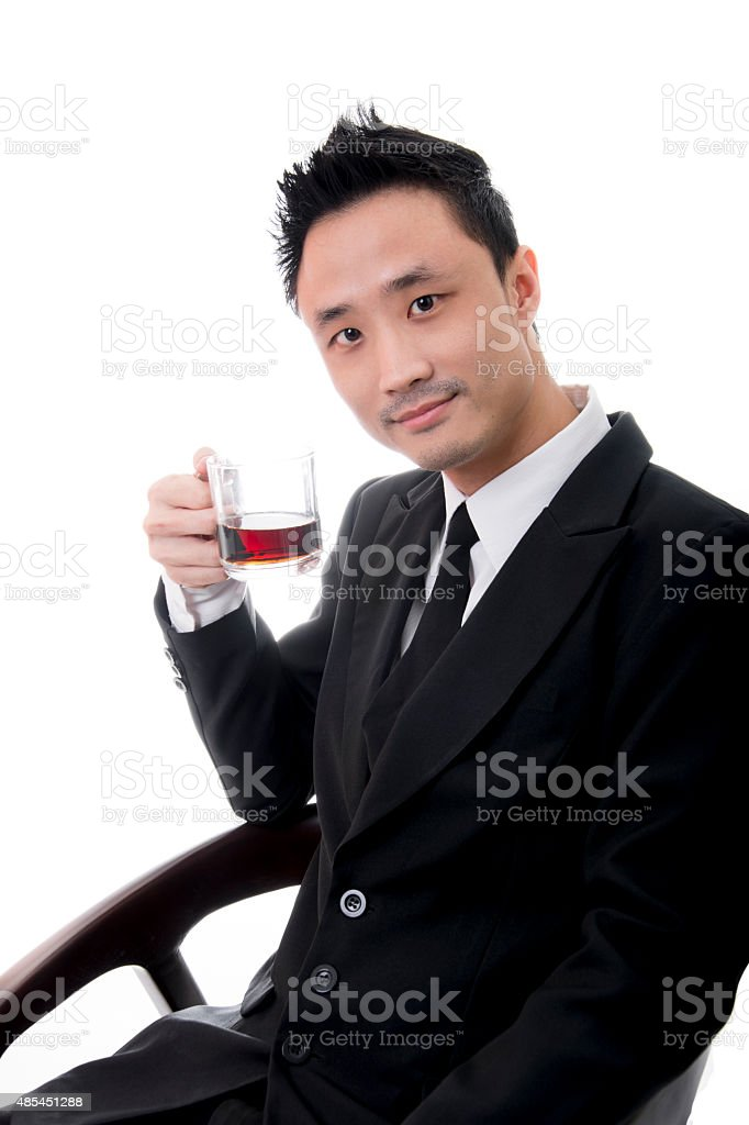 Young Asian Businessman Enjoying a Cup of Coffee royalty-free stock photo