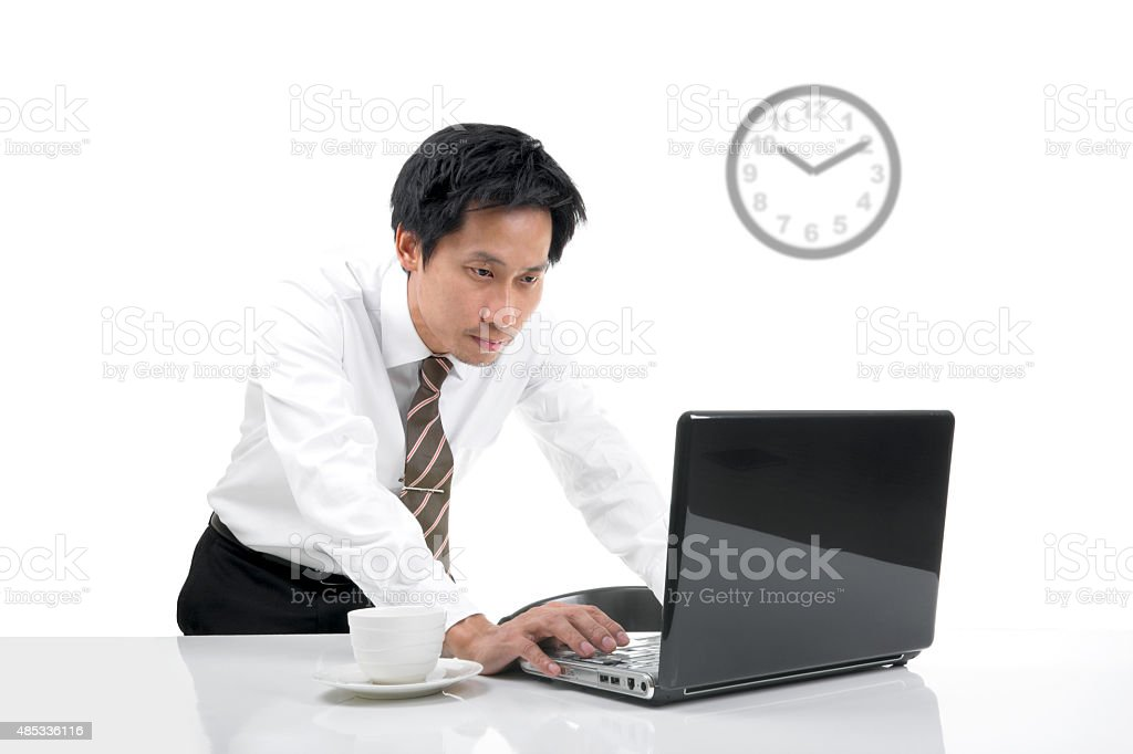 Young asian businessman looking screen of computer notebook royalty-free stock photo