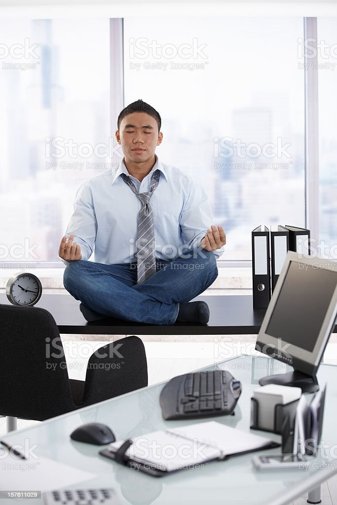meditation businessman office. young asian businessman meditating in office stock photo meditation f