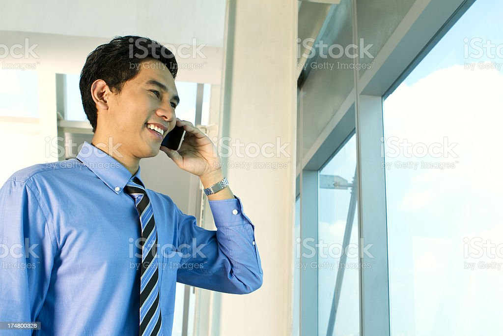 Young Asian businessman on the phone royalty-free stock photo
