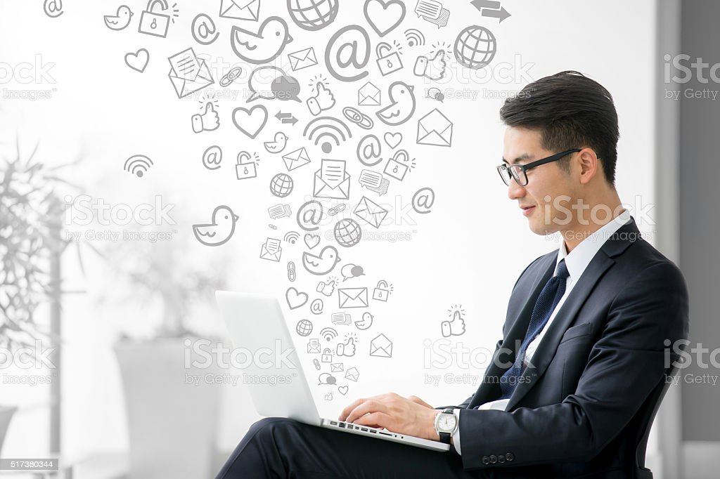 Young asian businessman using tablet, social media stock photo