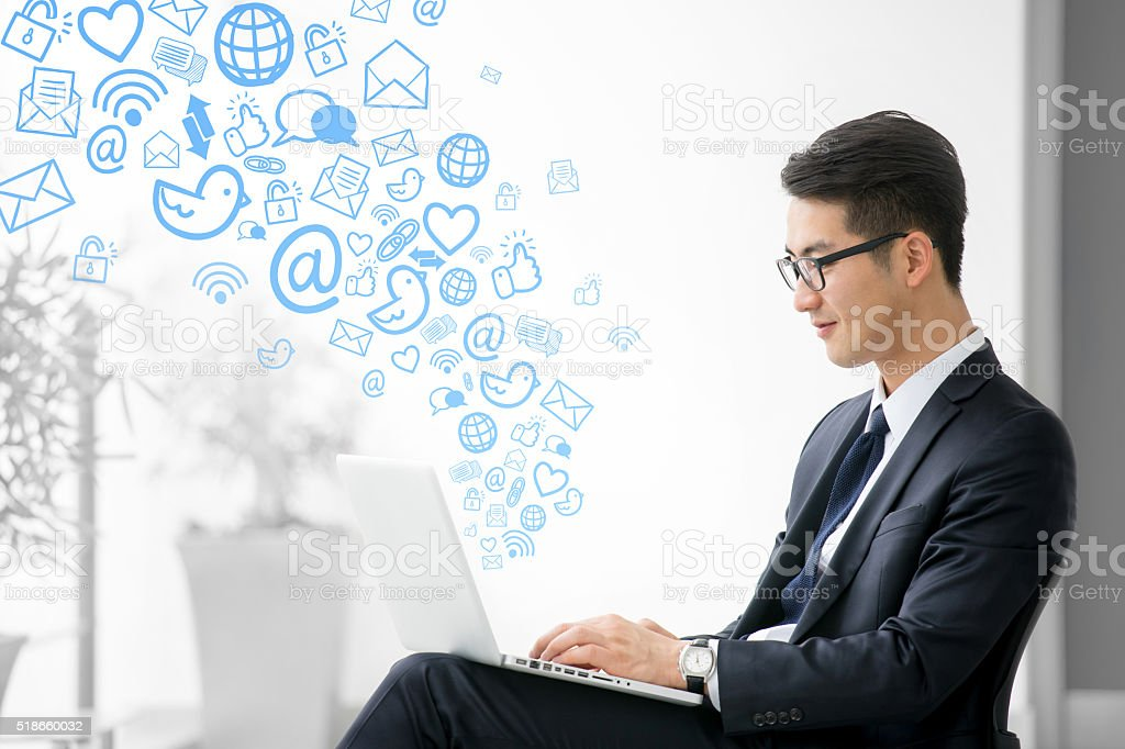 Young asian businessman using tablet, social meida stock photo