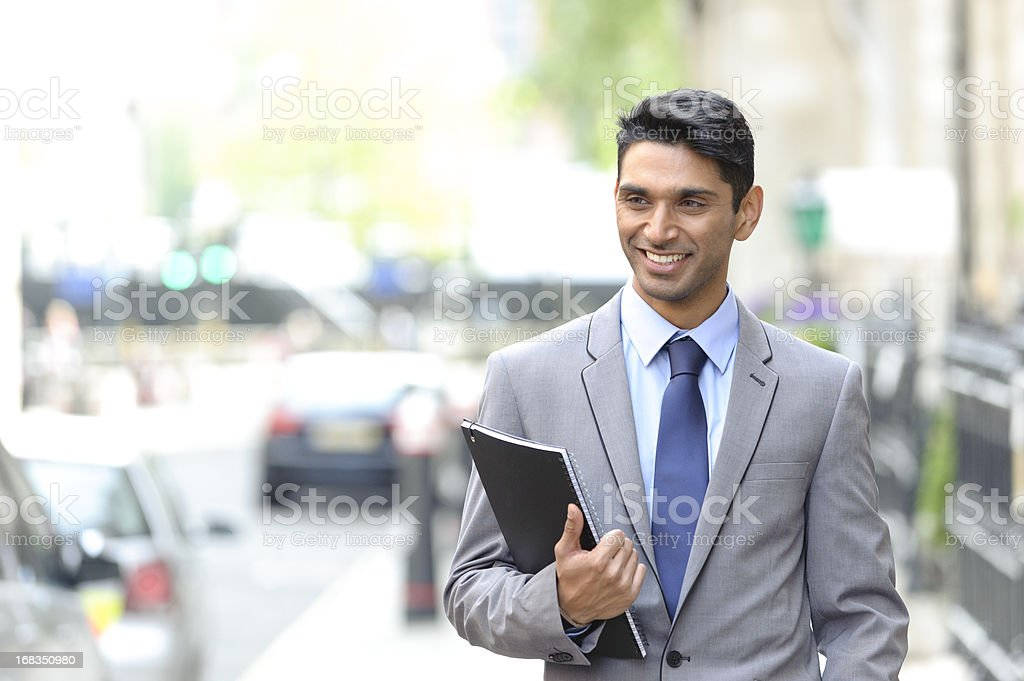 Young Asian Businessman Walking in the Street royalty-free stock photo
