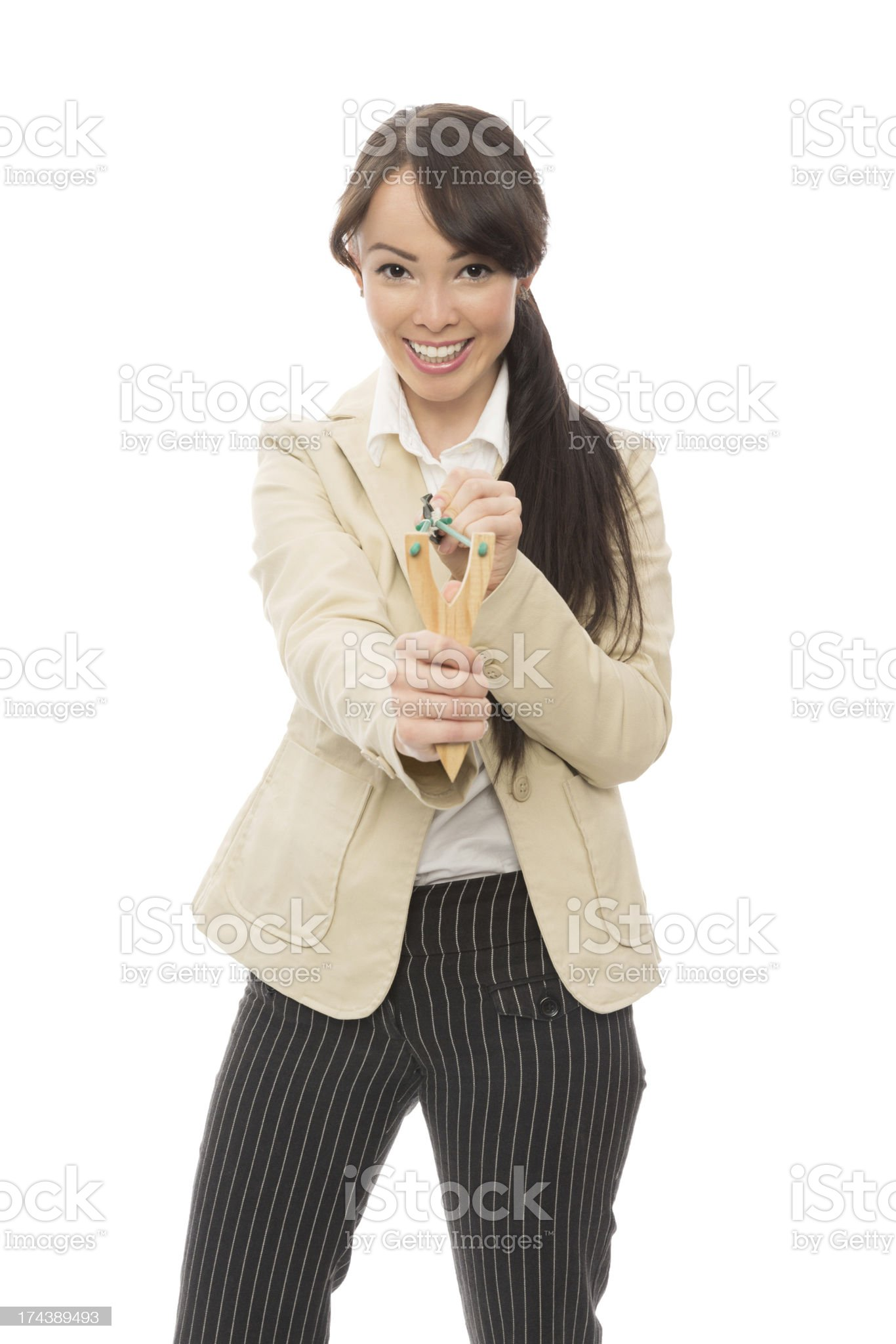 Young Asian Businesswoman Aiming With Slingshot royalty-free stock photo