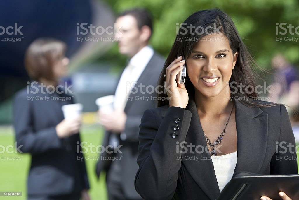Young Asian Businesswoman On Her Cell Phone royalty-free stock photo