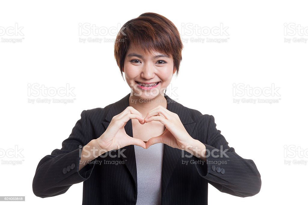Young Asian businesswoman show heart hand sign. stock photo