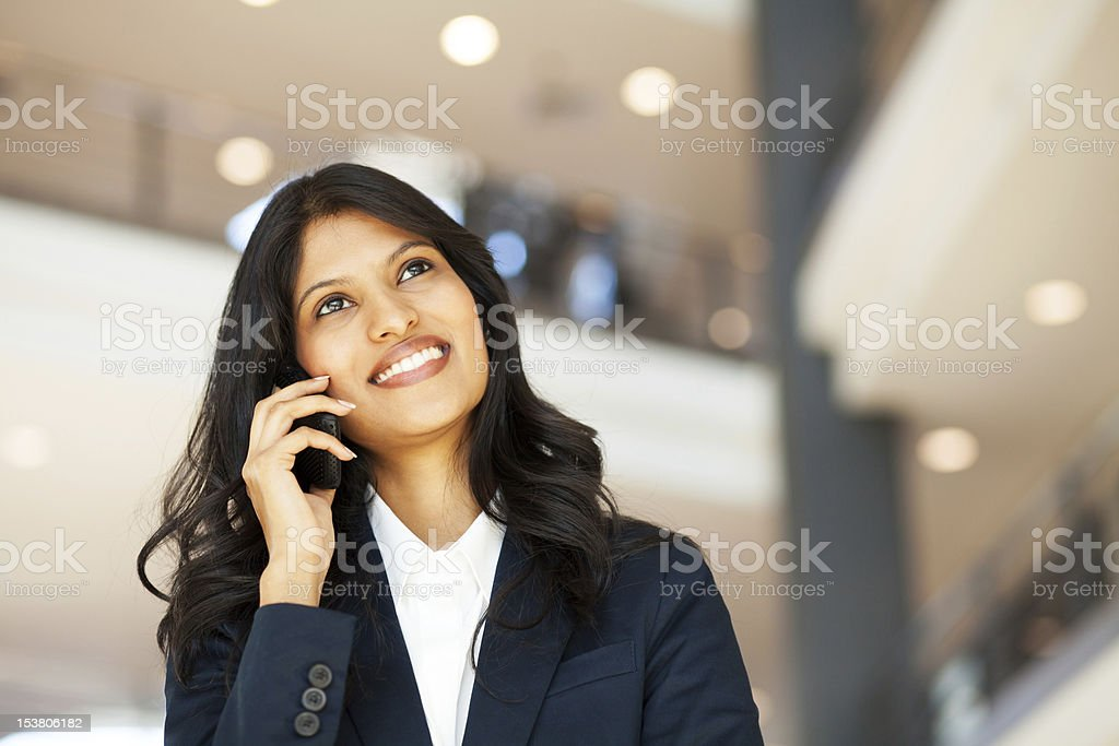 young asian businesswoman talking on mobile phone royalty-free stock photo