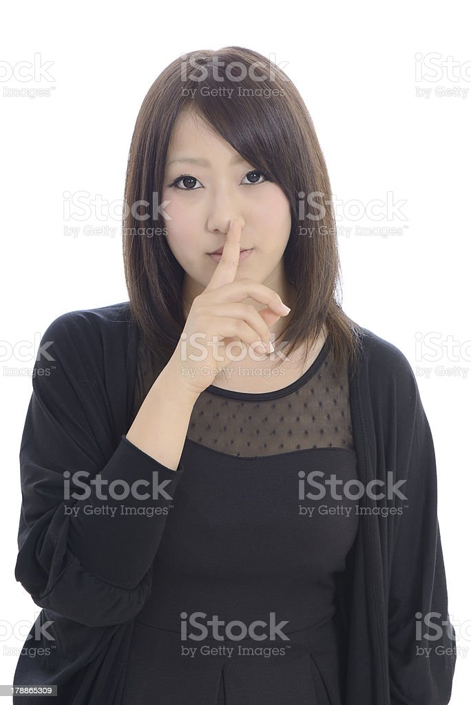 young asian businesswoman with silence gesture royalty-free stock photo