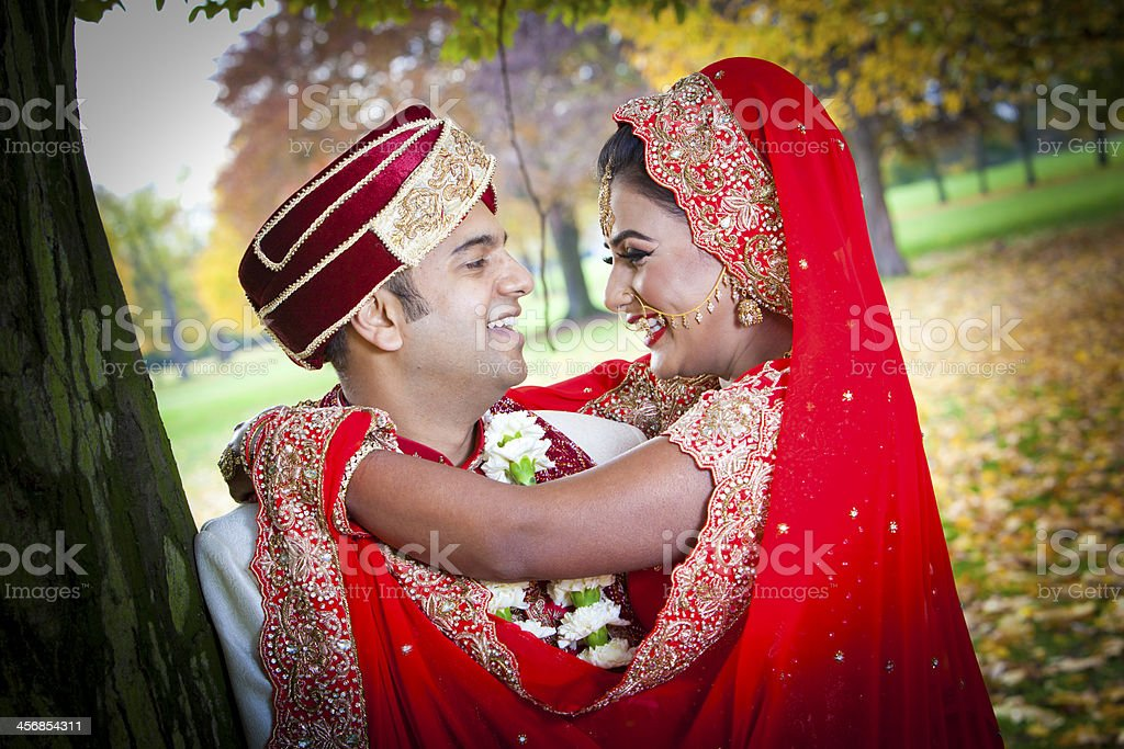 Young Asian couple in traditional dress royalty-free stock photo