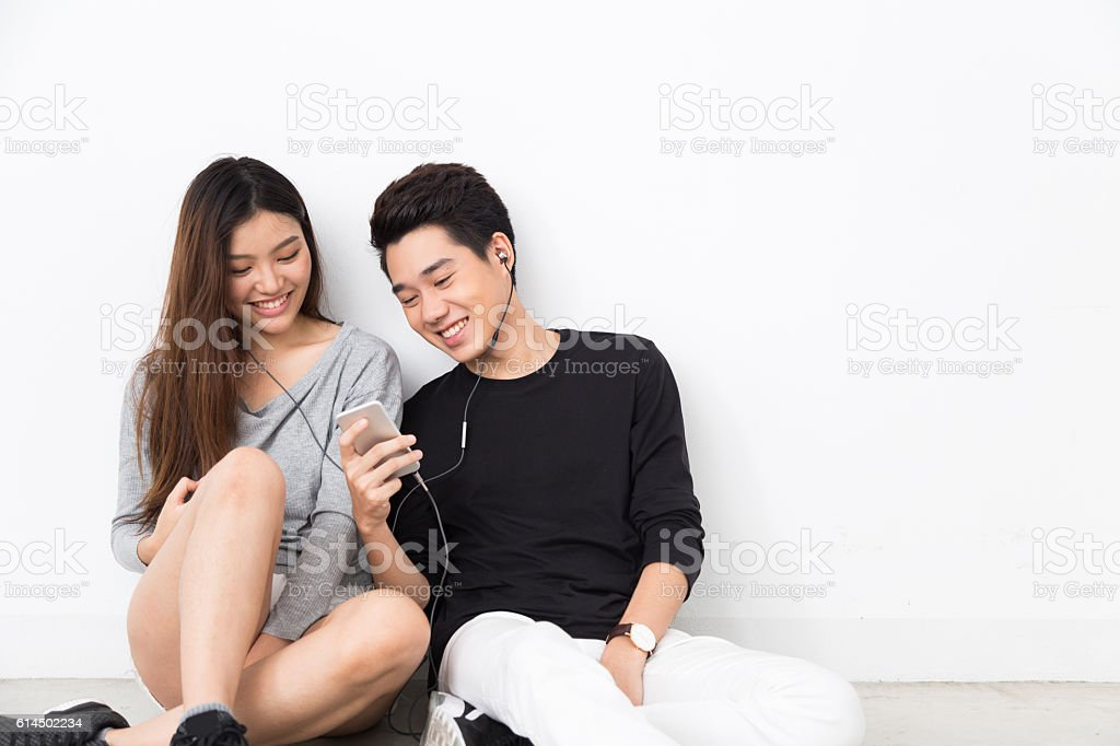 Young asian couple listen to music stock photo