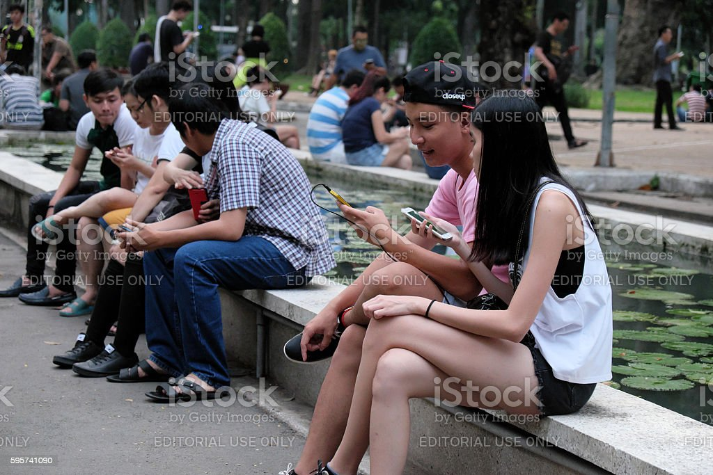 Young Asian couple play Pokemon go together stock photo