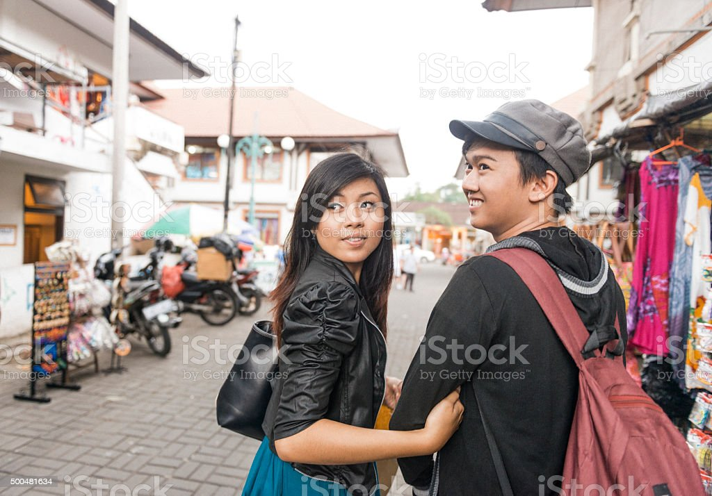 Young Asian Couple Walking in Ubud Market Outdoors Bali Indonesia stock photo