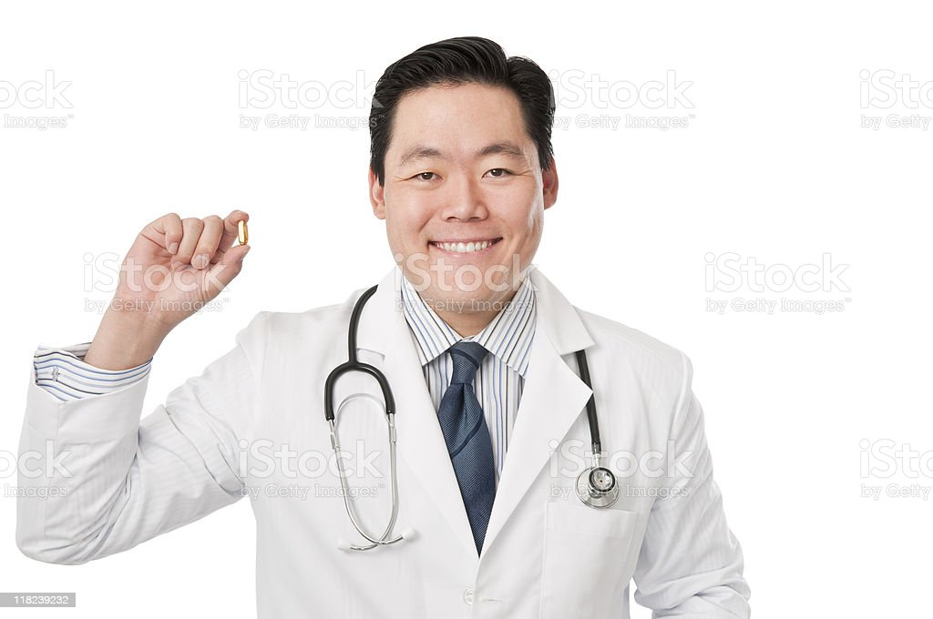 Young asian Doctor With Fish Oil royalty-free stock photo