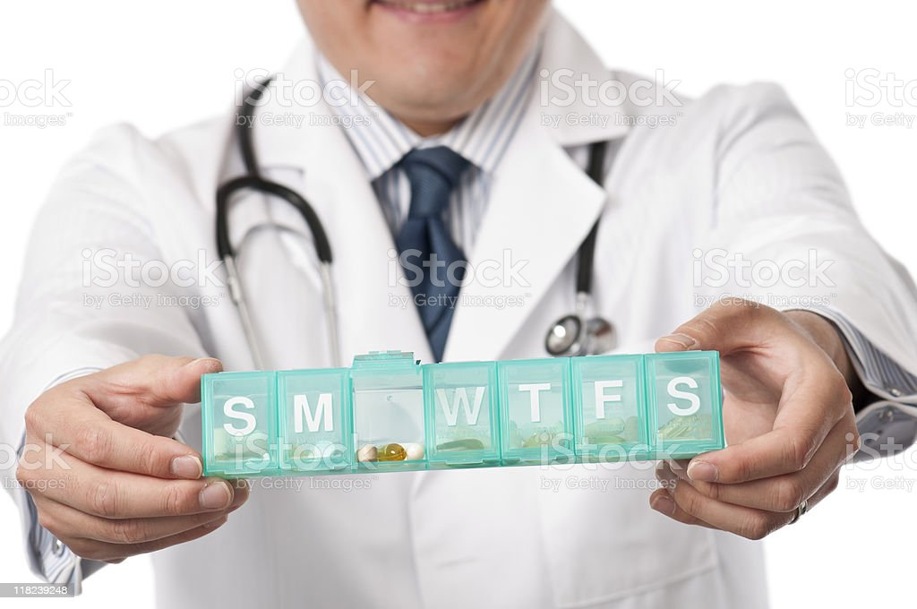 Young asian Doctor With Pill Box royalty-free stock photo