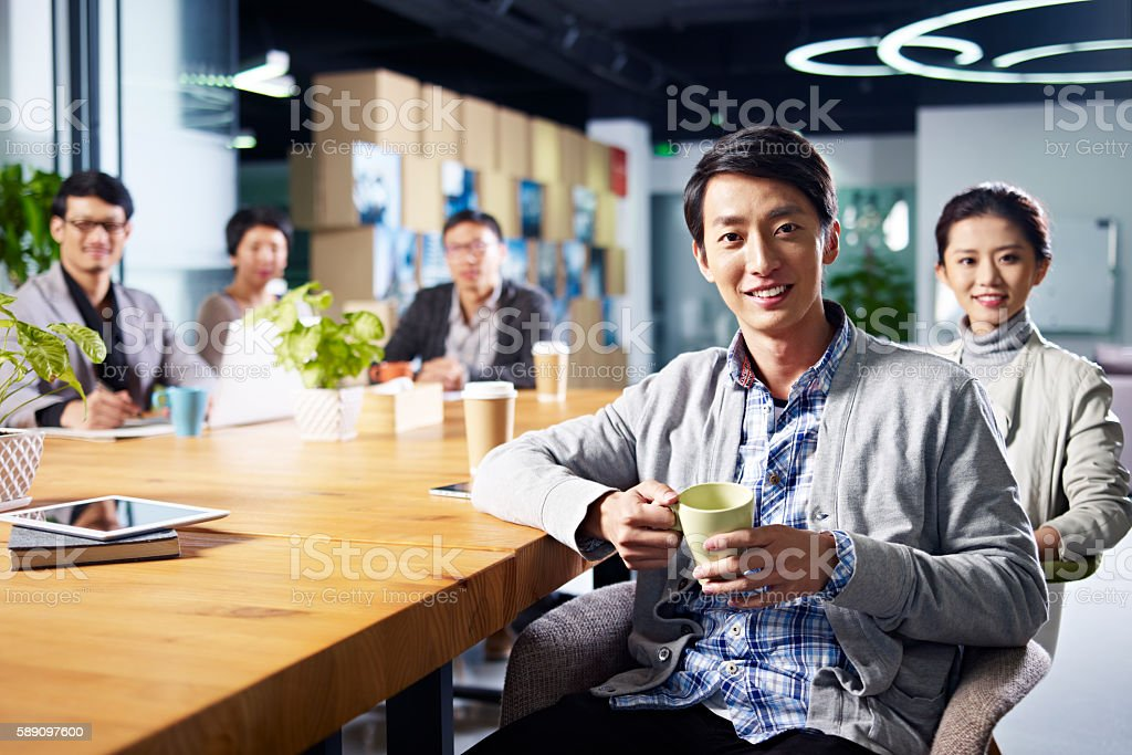 young asian entrepreneurs meeting in office stock photo