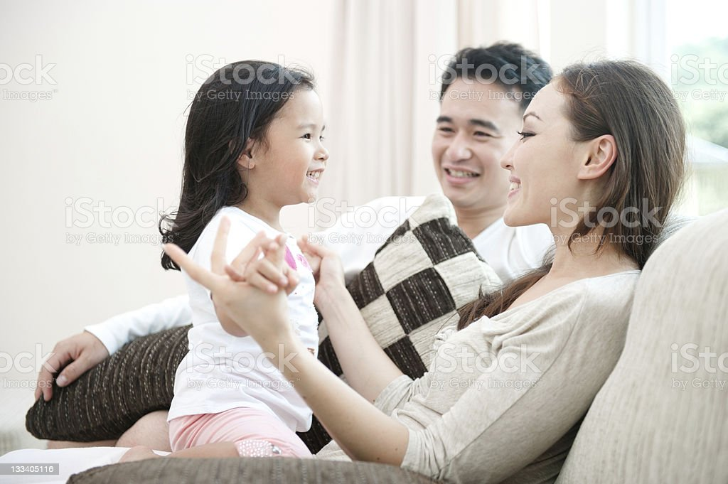 A young Asian family who are smiling  royalty-free stock photo