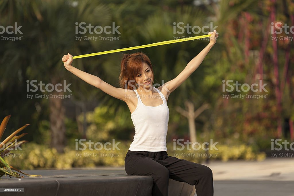 Young Asian Female Adult Healthy Lifestyle with rubber stretch b royalty-free stock photo