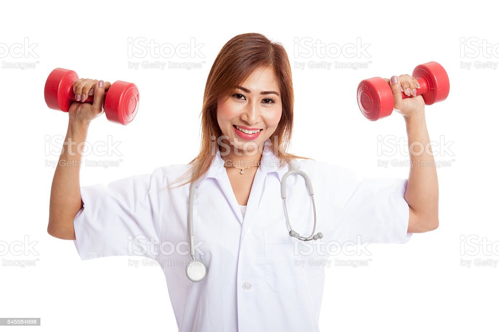 Young Asian female doctor with dumbbell in both hands stock photo