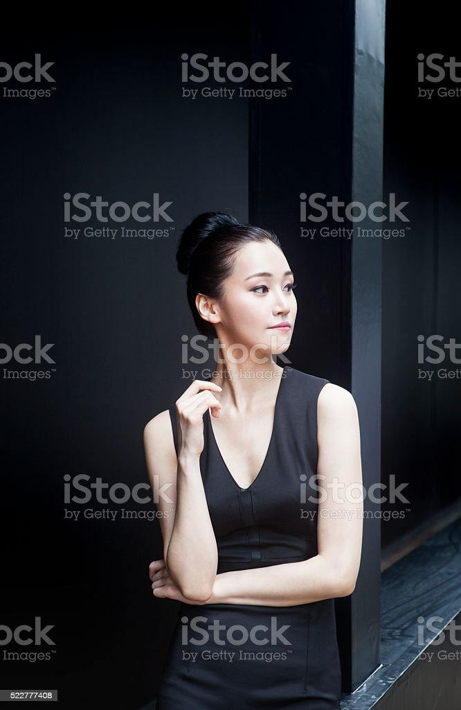 Young Asian Female On The Look Out Of Opportunities stock photo