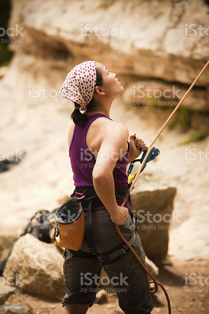 Young Asian Female Rock Climber Belaying royalty-free stock photo