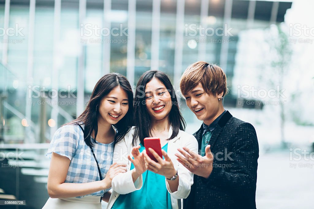 Young asian friends making selfie on street stock photo
