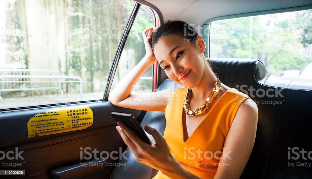 Young Asian Girl Chatting On Messenger With Her Boyfriend stock photo