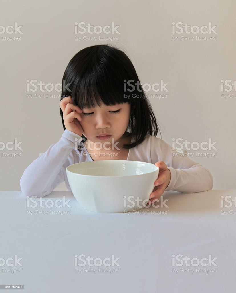 Young Asian Girl Doesn't Like Her Food stock photo