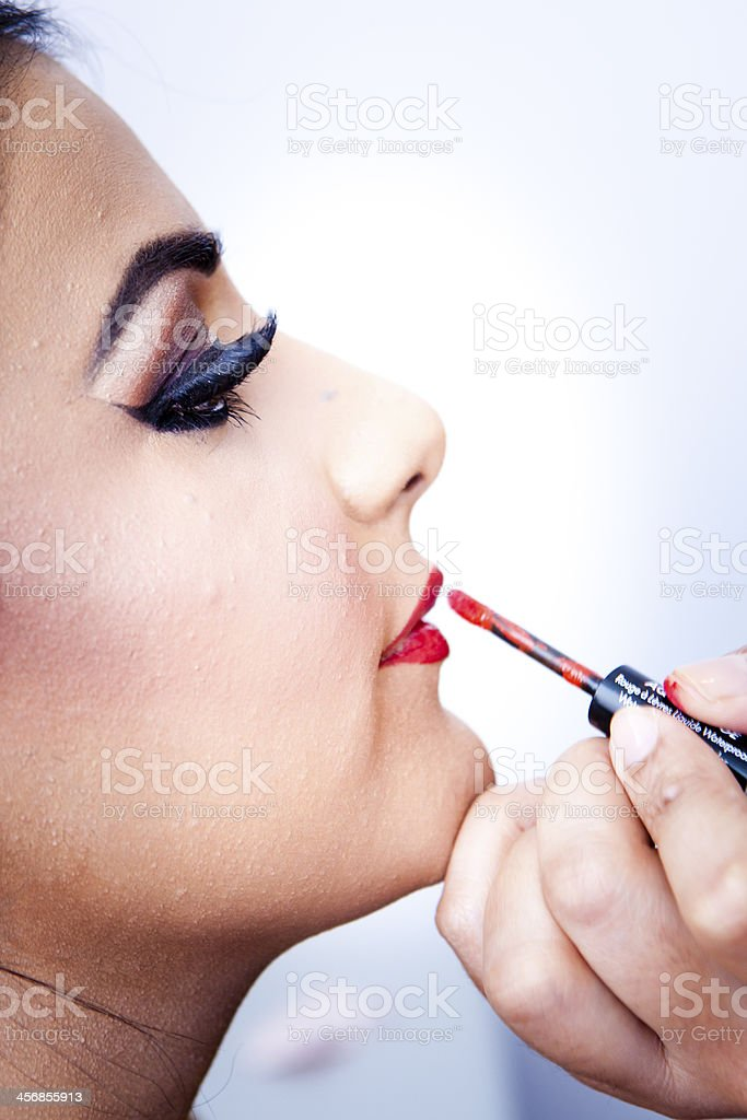 Young Asian girl getting lipstick applied royalty-free stock photo