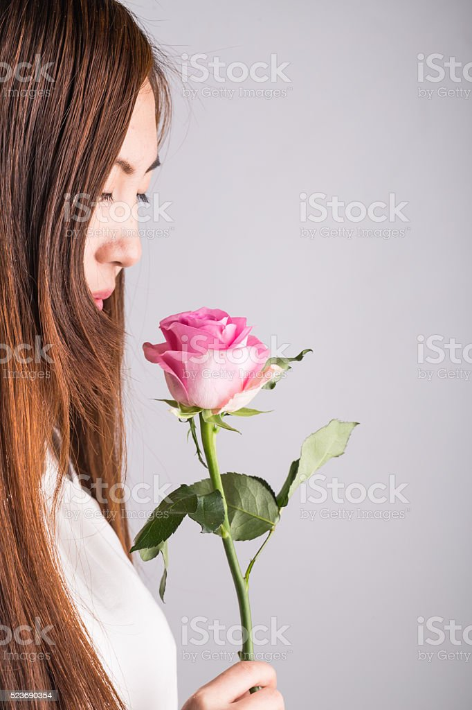 young asian girl holding rose stock photo