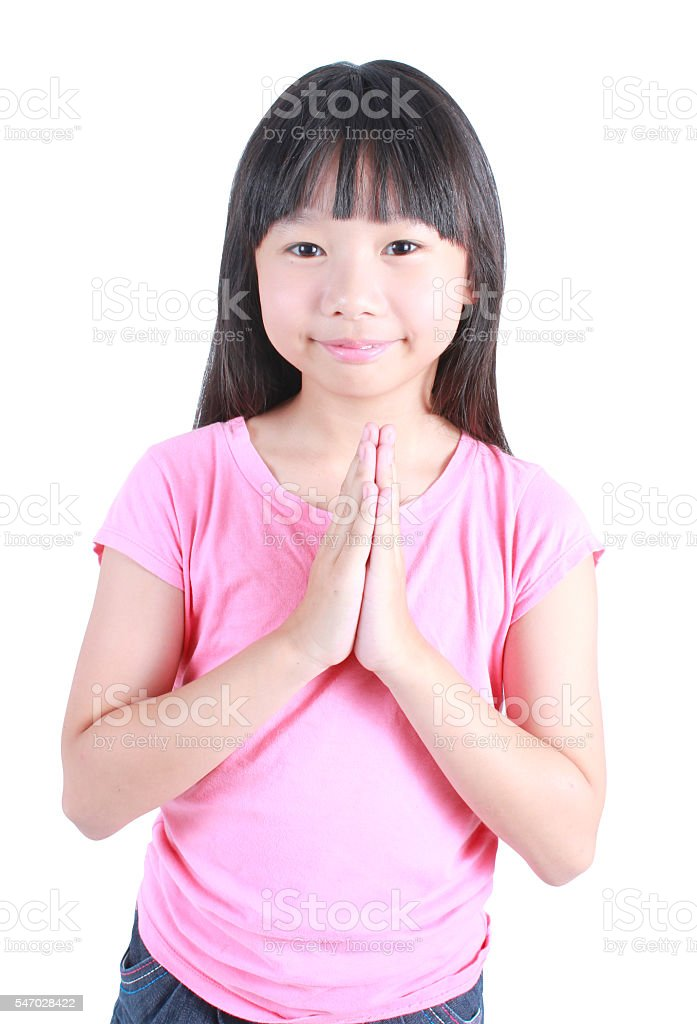 Young asian girl put her hands together and pray Lizenzfreies stock-foto