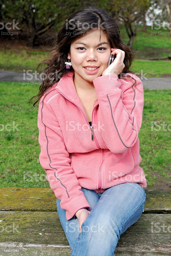 Young asian girl talking on a phone royalty-free stock photo