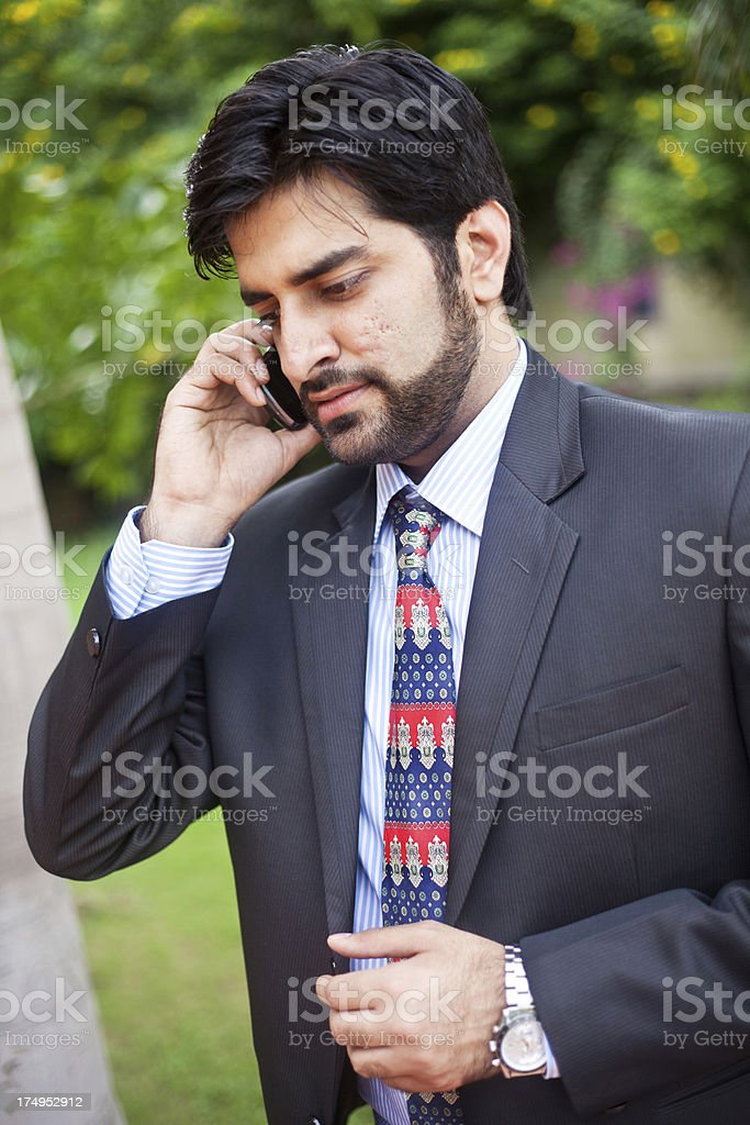 Young Asian Indian Businessman Talking On the Phone royalty-free stock photo