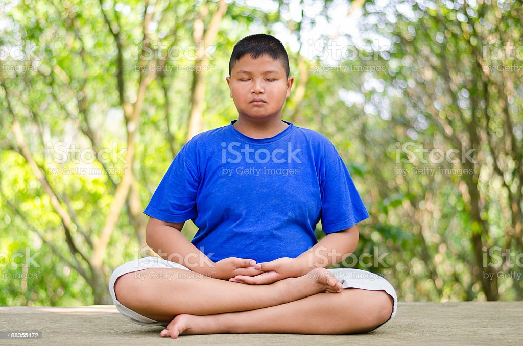 Young asian male teenager meditating stock photo