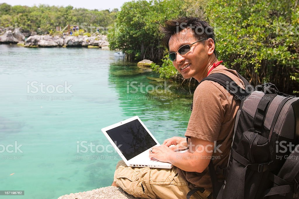 Asian Man Using Laptop on Hike royalty-free stock photo