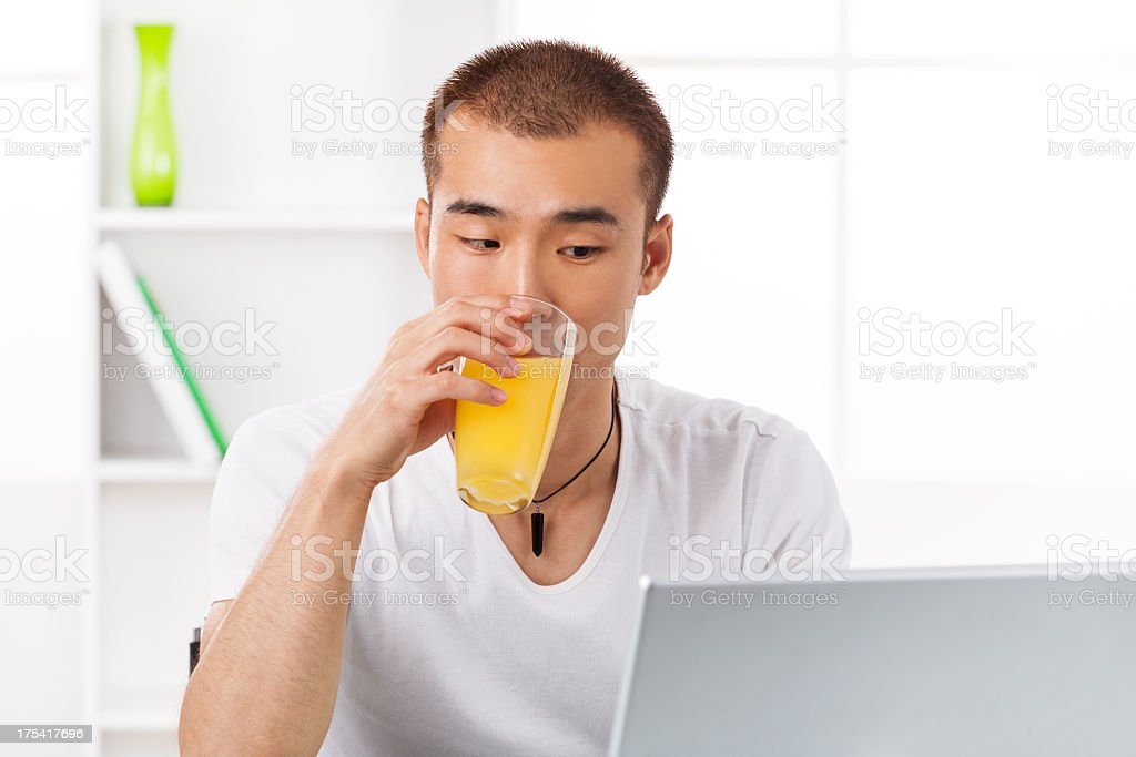 Young Asian male working at home royalty-free stock photo