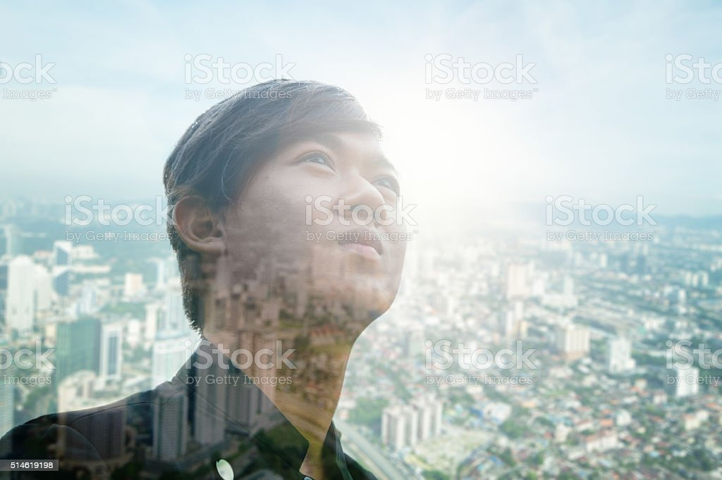 Young Asian man double exposure with Kuala Lumpur skyline stock photo