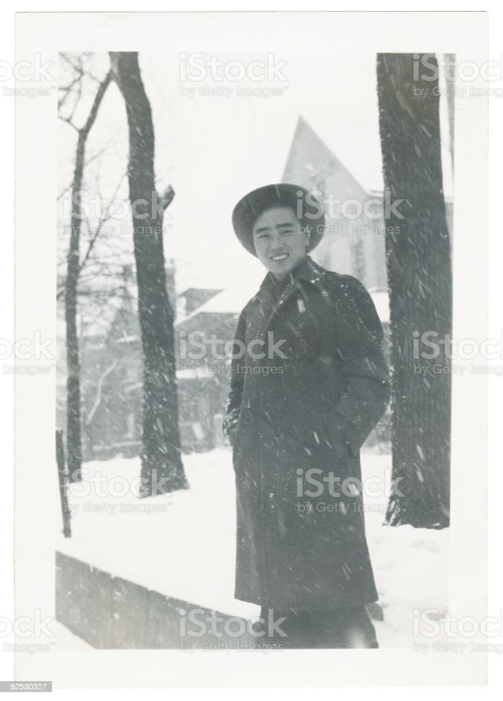 Young Asian Man in the Snow royalty-free stock photo