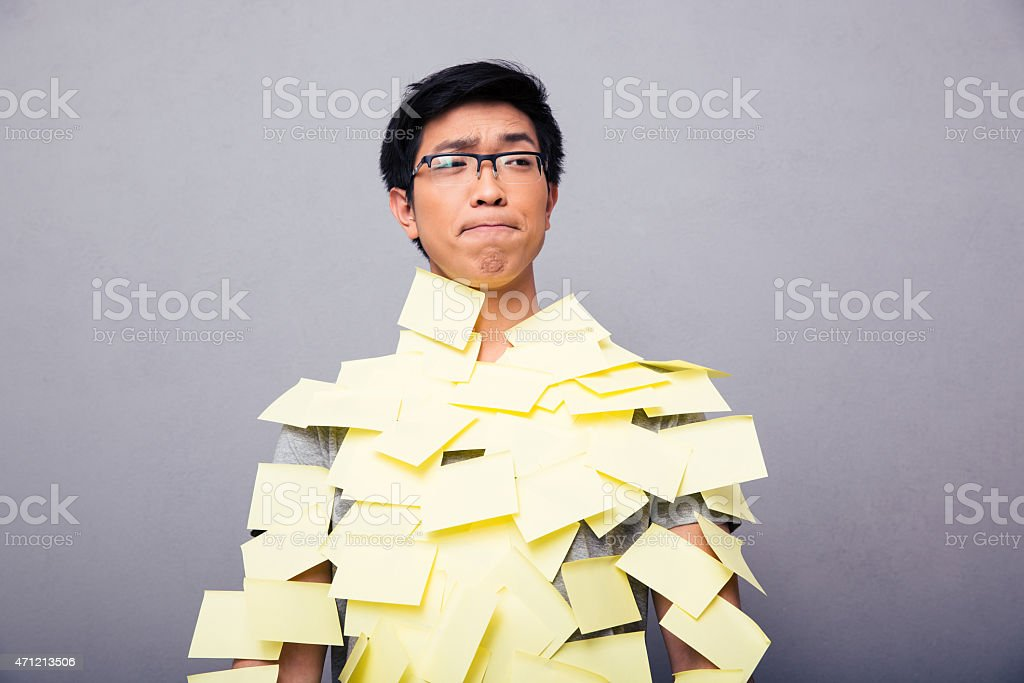 Young asian man pasted stickers stock photo