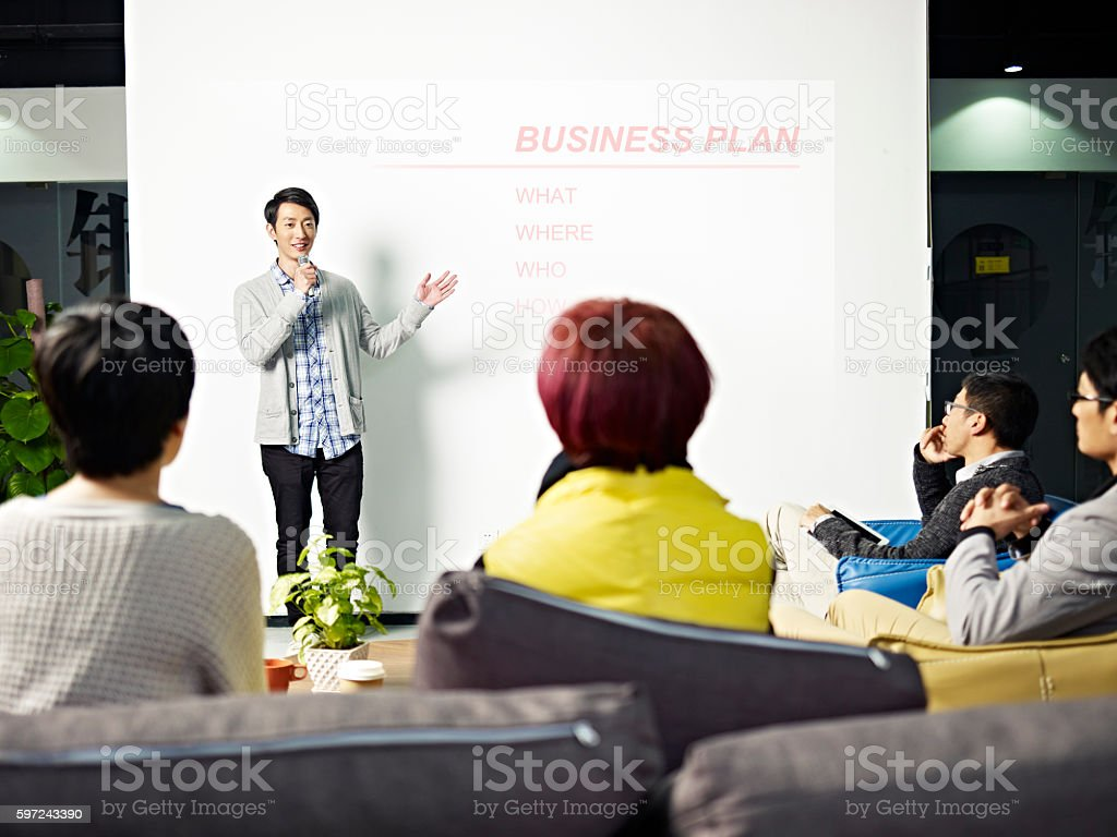 young asian man presenting business plan stock photo