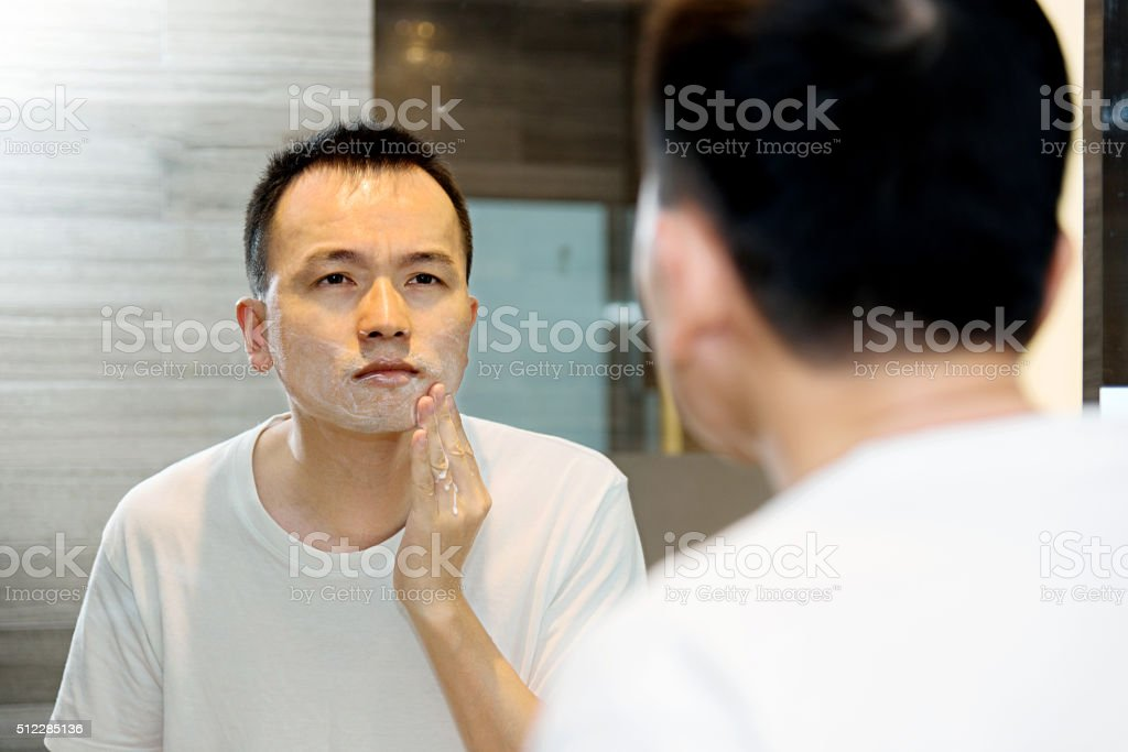 Young asian man shaving stock photo