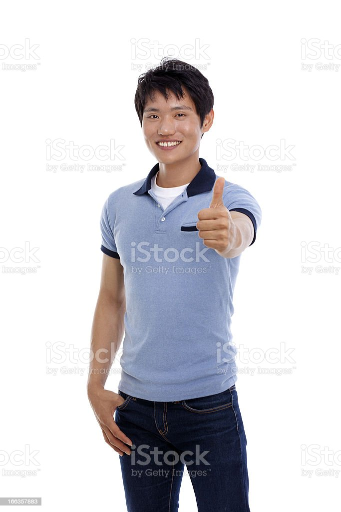 Young Asian man showing thumb. royalty-free stock photo