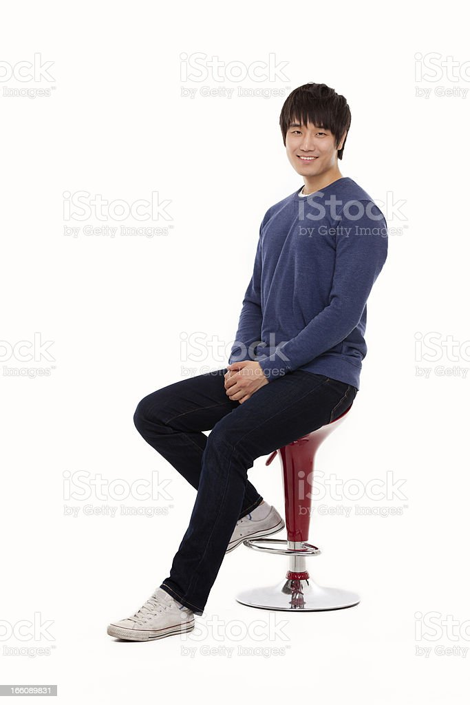 Young Asian man sitting on the chair. royalty-free stock photo