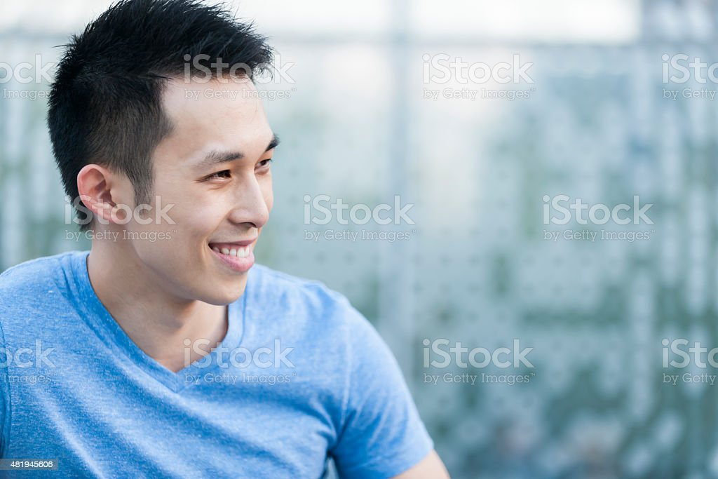 Young asian man smiling stock photo