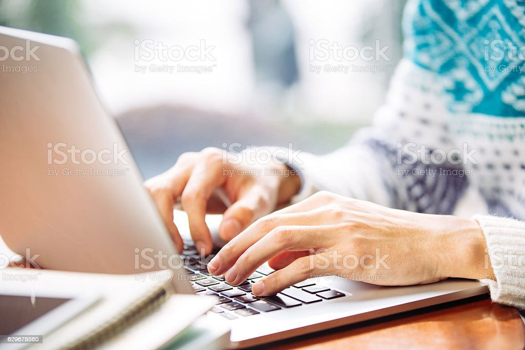 young asian man student using laptop stock photo