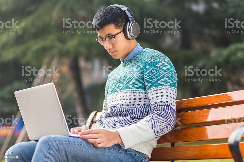 young asian man student with laptop stock photo