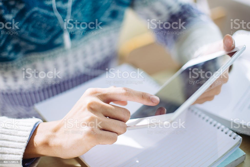 young asian man studying by tablet in classroom stock photo