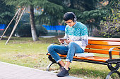 young asian man with mobile phone